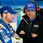 Dale Earnhardt Jr., left, and crew chief Greg Ives talk Feb. 27 before the Sprint Cup race in Atlanta. Earnhardt and Ives got their first victory together Sunday at Talladega.