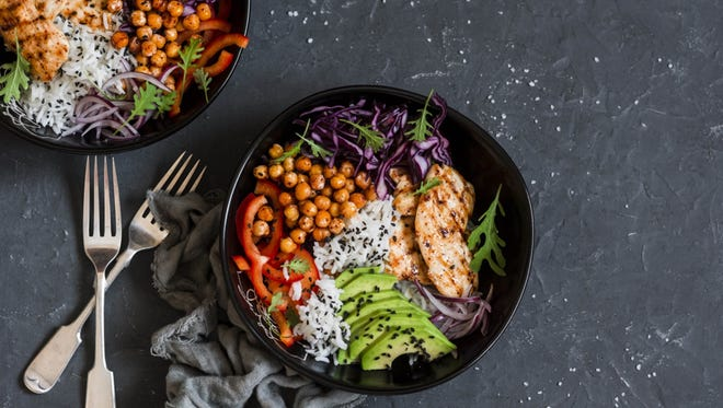 The well-known Buddha bowl (a filling mix of greens, raw or roasted veggies and a healthy grain, such as quinoa or brown rice) is one example of a portion-controlled handy meal, and is easy to tailor to your personal preferences.