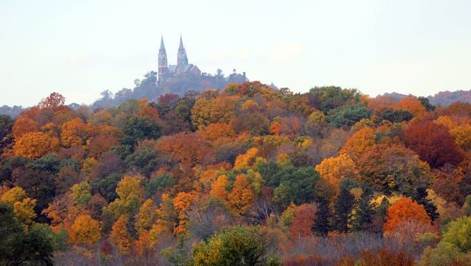A canopy of colorful leaves decorate the trees near The Basilica of the National Shrine of Mary, Help of Christians, at Holy Hill, in Erin on Oct. 12, 2015.