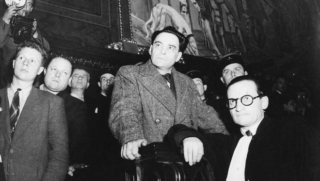 Dr. Marcel Petiot photographed at the moment in Paris on April 4, 1946, a few minutes before midnight, when he was sentenced to death for mass murder.