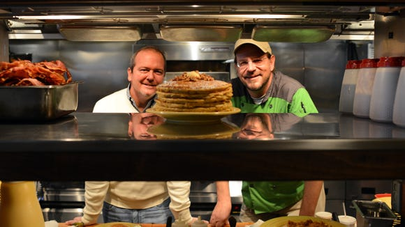 Steve Frabitore, who took over Tupelo Honey in 2008, left, and chef Brian Sonoskus, right.