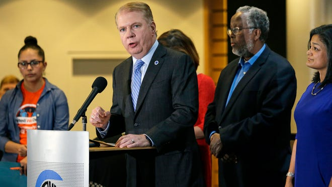 "In this Nov. 9, 2016, file photo, Seattle Mayor Ed Murray, second left, speaks at a post-election event of elected officials and community leaders at City Hall in Seattle. Leaders in Seattle, San Francisco and other so-called ""sanctuary cities"" say they won't change their stance on immigration despite President-elect Donald Trump's vows to withhold potentially millions of dollars in taxpayer money if they don't cooperate."