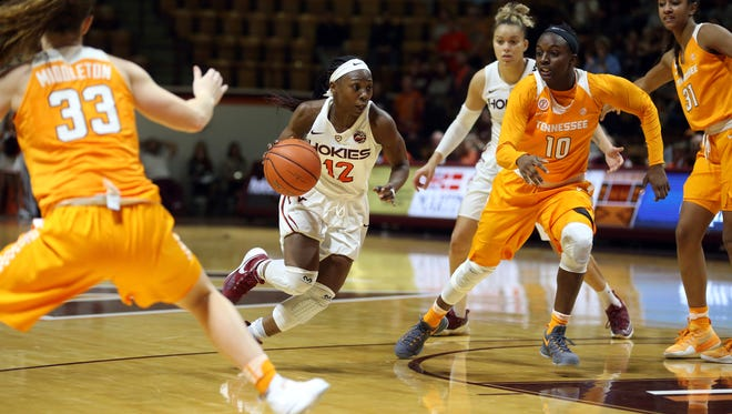 Virginia Tech's Chanette Hicks drives to the basket for a layup and a three-point play in the second half of Sunday's game against Tennessee in Blacksburg, Va.
