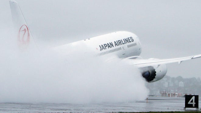 A Japan Airlines Boeing 787 takes off at Logan International Airport in Boston on its inaugural, nonstop flight from Boston to Tokyo on April 22, 2012.