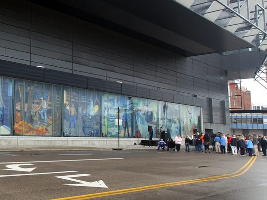 Nine murals created by Winold Reiss in the early 1930s for Union Terminal have been re-installed on the west face of the Duke Energy Convention Center. A dedication ceremony for the display happened Thursday.
