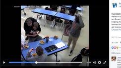 Freshman Ian Brown performs the Heimlich maneuver on