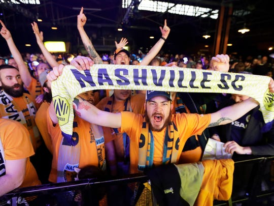 Soccer fans celebrate as the name of Nashville's team, Nashville Soccer Club, is announced along with team name, logo and colors in February. File photo.