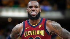 A dejected Cleveland Cavaliers forward LeBron James