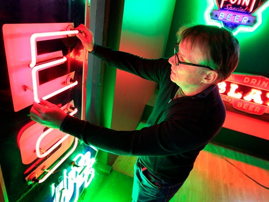 """Jed Schleisner turned from student at the American School of Neon in Minneapolis to collector in 1985 when a classmate and antique collector from Winnepeg showed off a carload of neon signs. """"I thought that was the coolest thing ever,"""" Schleisner said. """"His enthusiasm rubbed off on me."""""""