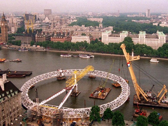The final rim section of the British Airways London Eye big wheel was laid in place in 1999, encircling the hub and spindle and column legs on London's South Bank.