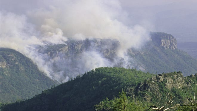 The 2007 Shortoff Mountain fire in the Linville Gorge area photographed from the west side of the gorge by Asheville nature photographer Linda Denton. The fire was started by a lightning strike.