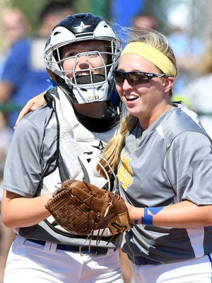 McNairy Central's Katie Turner (31) and Tori Yord (44) at the end of an inning during game one of the 2017 Class AA State Girls' Softball Championship against Christian Academy of Knoxville, Friday, May 26. CAK defeated McNairy County in two games, 2-1, 2-1.