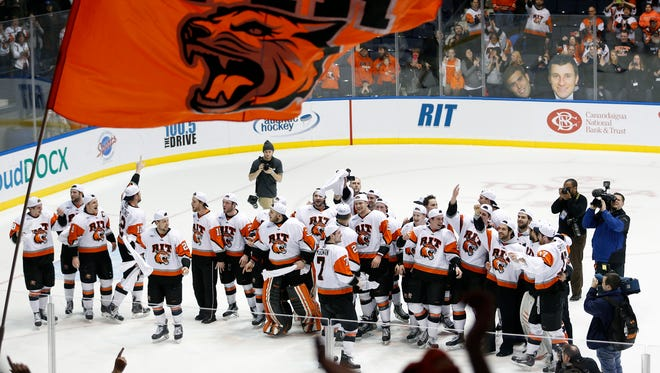 RIT celebrates its 5-1 win over Mercyhurst at the Blue Cross Arena at the War Memorial in Rochester.