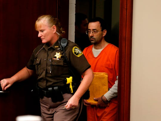 Former Michigan State University and USA Gymnastics doctor Larry Nassar arrives at Ingham County Circuit Court on Nov. 22 in Lansing, Mich.