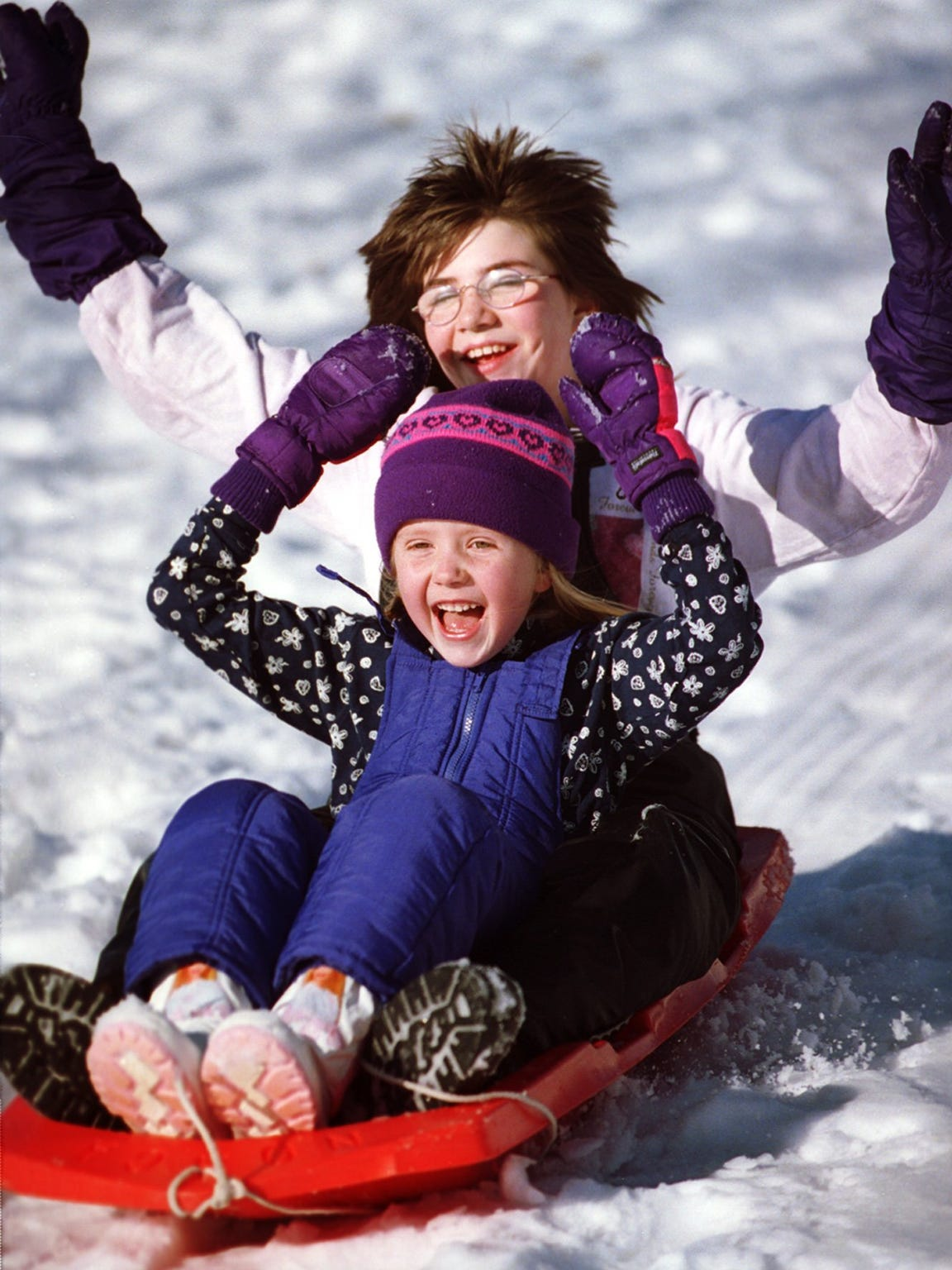 In this 1999 file photo, Laura Brunner and Laticia Shepler,  both of Wausau, sled down the hill on a sunny, warm afternoon at Pleasant View park on Wausau's east side.