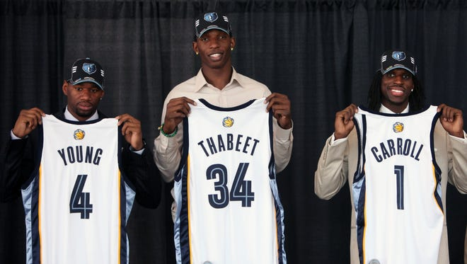 Grizzlies draft picks, from left, Sam Young (36th pick), Hasheem Thabeet (second) and DeMarre Carroll (27th) hold up their new team jerseys at a press conference June 26, 2009.