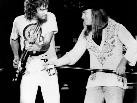 Lynyrd Skynyrd lead singer Ronnie Van Zant, right urges on guitarist Steve Gaines during a performance at Convention Hall in Asbury Park, New Jersey, July 20, 1977.