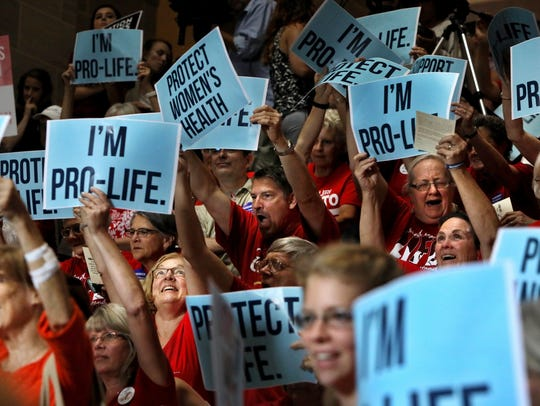 People cheer during an anti-abortion rally in the Missouri Capitol in Jefferson City on June 14, 2017.