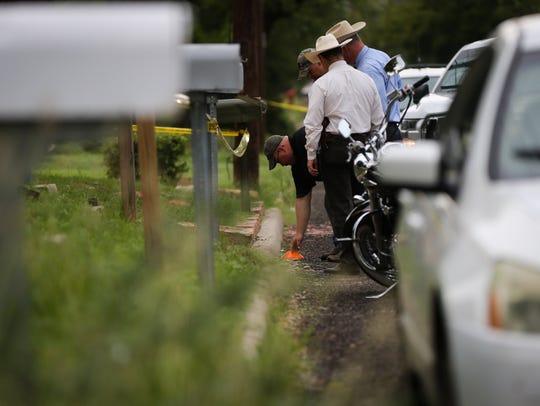 Investigators from several law enforcement agencies