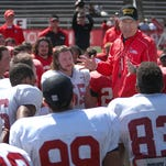 Ball State football coach Pete Lembo guides his team during the 2014 spring game. Figures released Wednesday reveal Lembo is the second highest-paid coach in the MAC.