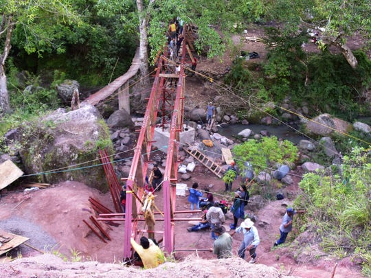Construction of the bridge was completed with few modern conveniences and a lot of hard work.