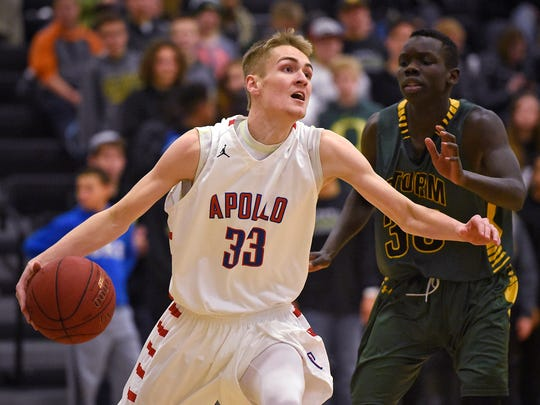 Apollo's Ben Giese drives to the basket during the first half of Thursday's game at Sauk Rapids-Rice High School.