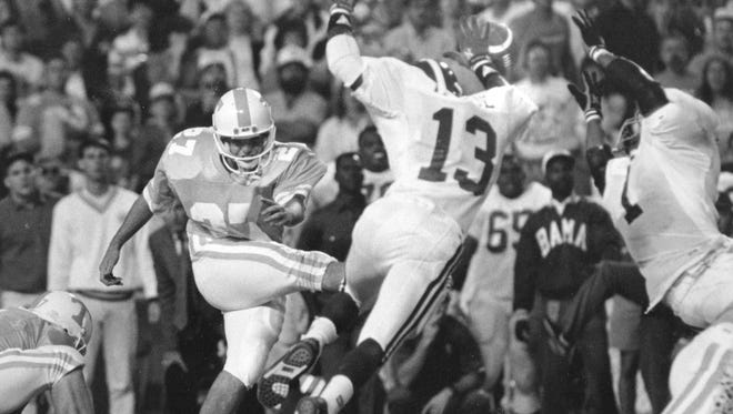 Tennessee's Greg Burke's field goal attempt in the fourth quarter which would have won the game for Tennessee was blocked by Alabama's Stacey Harrison (1) and George Teague (13) on October 20, 1990.
