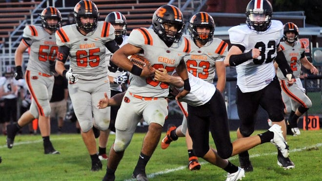 Deontae Brandon, of Ridgewood, runs through a tackler from Tuscarawas Valley on Friday night in West Lafayette.