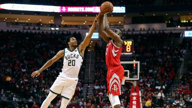 Rockets guard James Harden shoots against Bucks guard Rashad Vaughn in the second quarter Saturday night.