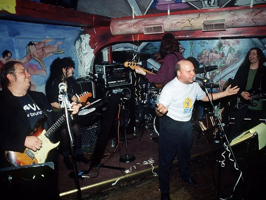 The Slaves of New Brunswick with  guitarist Bernie Brausewetter (left), Donna Dior (top) Tony Shanahan (back to camera), Matt Pinfield (middle) and Jack Shepherd (right) upstairs at the Melody Bar in 1991.