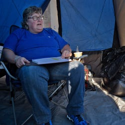 Angie Tatum pitches a tent to begin the line for Black Friday deals at BestBuy electronics store Wednesday, Nov. 25, 2015, in Nashville, Tenn.