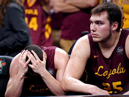 Loyola Ramblers guard Clayton Custer (13) and center