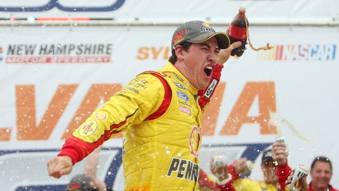 NASCAR Sprint Cup Series driver Joey Logano celebrates in victory lane after winning the Sylvania 300 at New Hampshire Motor Speedway.