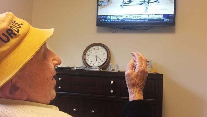 Micky Kor celebrates a Purdue basket during the Boilers' win over Michigan State on Saturday, Feb. 18. A series of illnesses have kept Kor, a Holocaust survivor, from his season ticket seat at Mackey Arena, but he still won't miss a game from his room in a Terre Haute assisted living facility.