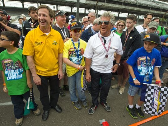 With a four-lane, one-mile track assembled on the front straightaway of the Indianapolis Motor Speedway, four young drivers launched their Hot Wheels cars into the record books with the coaching of legendary Indy 500 drivers Mario and John Andretti. / Doug McSchooler/for The Star