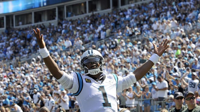 Then-Panthers quarterback Cam Newton celebrates a touchdown against the Los Angeles Rams last September. Newton has made a good impression with his new teammates in Foxboro.