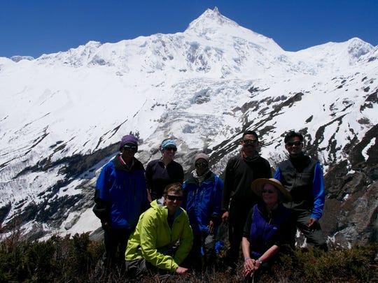 In back row, from left, Kadgha Rai, Sarah Sentz, Padam