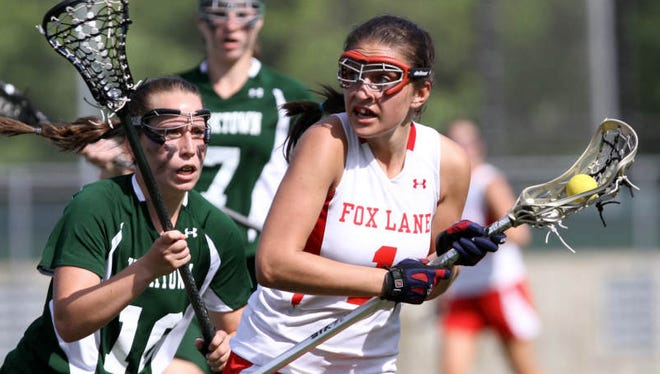 Fox Lane's Sammy Jo Tracy (1) moves the ball up the field against Yorktown during the girls lacrosse Class B championship at Yorktown High School May 25, 2011. Yorktown won the game 16-15.