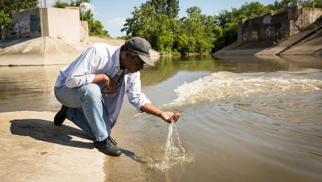 """Visiting Chicago-based artist Pope L. is a big name in the art world, known for his highly political, performance-based works dealing with issues of identity and social justice. """"Pope L. & The Flint Water Project"""" is on display atWhat Pipeline through Oct. 21."""