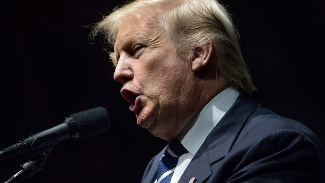 """FILE - In this Dec. 9, 2016 file photo, President-elect Donald Trump speaks in Grand Rapids, Mich.  Trump says he'll reduce the costs of the Pentagon's most expensive weapons program, Lockheed Martin's F-35 Joint Strike Fighter, after he takes office.  The president-elect tweeted Monday that the """"F-35 program and cost is out of control. Billions of dollars can and will be saved on military (and other) purchases after January 20th."""" (AP Photo/Andrew Harnik, File)"""