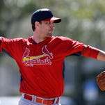 St. Louis Cardinals pitcher Adam Wainwright throws a bullpen session during spring training baseball practice Friday, Feb. 20, 2015, in Jupiter, Fla. (AP Photo/Jeff Roberson)