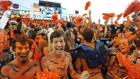 Auburn fans cheer as the final seconds of the Alabama
