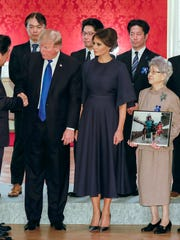 The Trumps and the Abes met with families of Japanese