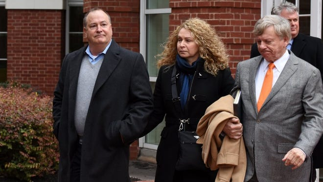 Former Pilot Flying J President Mark Hazelwood, left, leaves court after being arraigned Feb. 9 on charges including conspiracy to commit wire fraud and mail fraud as well as witness tampering. Seven other Pilot employees were also named in the 14-count indictment. Hazelwood and the attorneys are asking a federal judge to move their trial away from Knoxville.