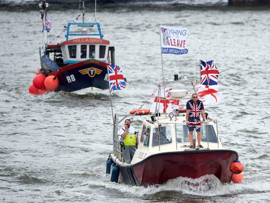 A pro-Brexit flotilla of fishing boats sailed up the