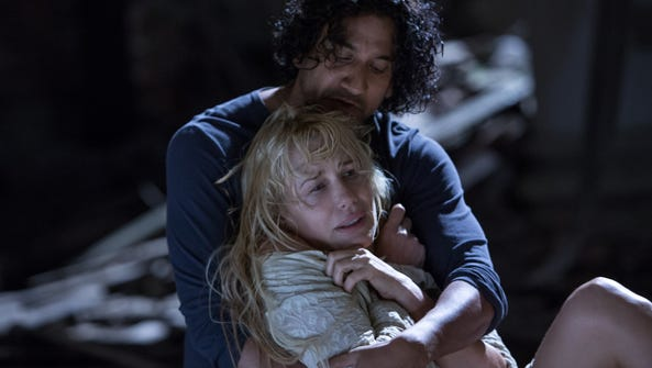 Naveen Andrews (rear) and Daryl Hannah in a scene from Netflix's series