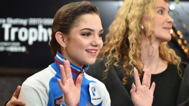 Russia's Evgenia Medvedeva (left) reacts following the announcement of her results after the women's singles short program of the Grand Prix of Figure Skating 2017/2018 NHK Trophy in Osaka on Nov. 10.