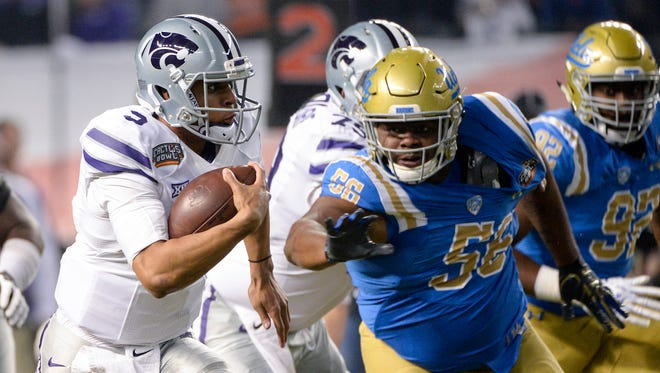 Dec 26, 2017: Kansas State Wildcats quarterback Alex Delton (5) runs the ball under pressure from UCLA Bruins defensive lineman Greg Rogers (56) during the first half in the 2017 Cactus Bowl at Chase Field.