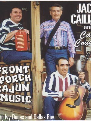 "Dallas Roy, top right, is pictured with Jackie Caillier, left, and Ivy Dugas on the 1996 CD, ""Front Porch Cajun Music."""