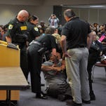 Deputies carry school board candidate Dean Paterakis from the room after he sat on the floor to protest his ejection from a May 24 Brevard Public Schools board meeting.